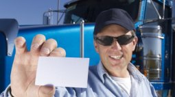 Truck_Driver_Holding_Card
